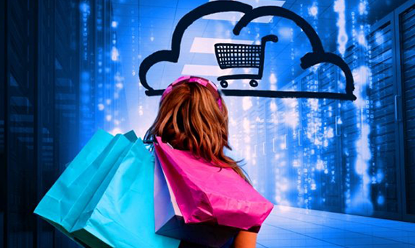 Imagem. Menina de costas, de cabelo castanho e faixa rosa na cabeça, segura em seu ombro sacolas rosas e azuis. Na frente dela uma nuvem com um carrinho de compras desenhado e um fundo azul que remete há algo computadorizado.