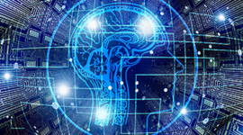 Imagem. Cabeça de um homem com contorno azul e com o desenho do cérebro. A cabeça está rodeada por um círculo azul e atrás um fundo que remete a computação.