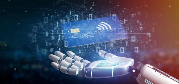 Mão de robô segurando um cartão de crédito virtual para representar a inteligência artificial e o varejo.